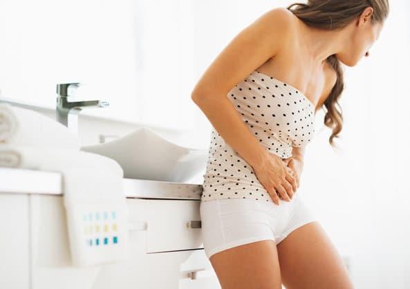 Сильные боли при месячных - причины и лечение
