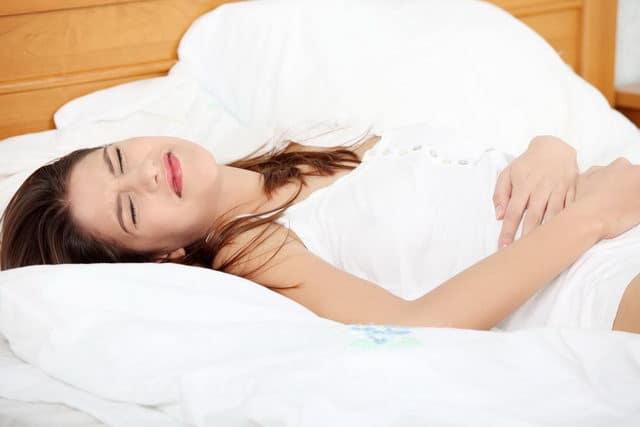Болит низ живота после месячных: причины и лечение