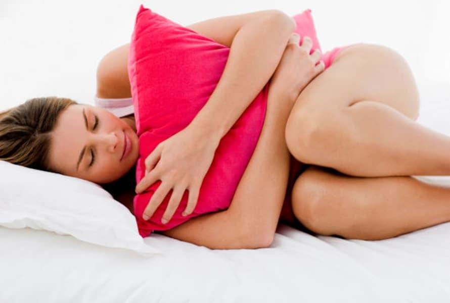 Тянущие боли внизу живота в области матки после месячных