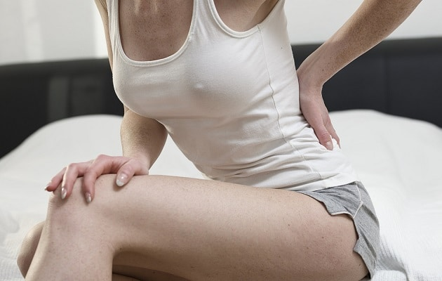 Почему при и перед началом месячных болит поясница